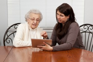 Young Woman and Grandmother Using Tablet Computer
