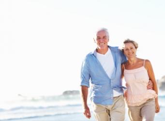 Retired Couple on Beach Long Term Care Insurance